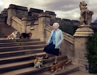 In this official photograph released by Buckingham Palace Wednesday April 20, 2016 to mark her 90th birthday, Queen Elizabeth II is seen walking in the private grounds of Windsor Castle, in England, on steps at the rear of the East Terrace and East Garden with four of her dogs: clockwise from top left Willow (corgi), Vulcan (dorgie), Candy (dorgie) and Holly (corgi). (© 2016 Annie Leibovitz via AP) MANDATORY CREDIT